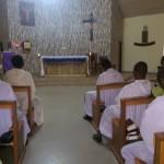 The brothers in prayer.           Jos, Nigeria