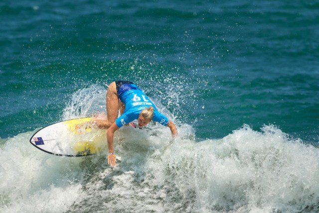 Photograph of Ella Williams of New Zealand during the women's surfing competition at Tsurigasaki Surfing Beach at the Tokyo 2020 Olympics.