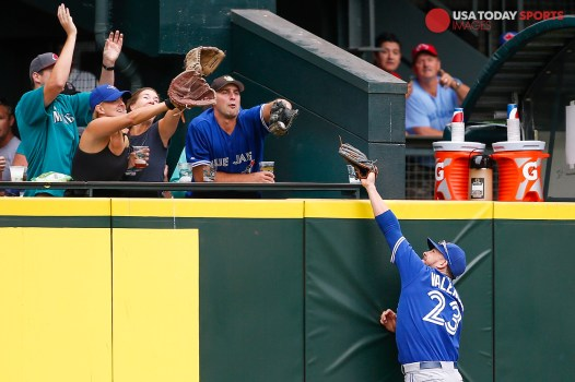 Jul 25, 2015; Seattle, WA, USA; Toronto Blue Jays left fielder Danny Valencia (23) fails to catch a three-run homer off the bat of Seattle Mariners second baseman Robinson Cano (22, not pictured) during the fourth inning at Safeco Field. Mandatory Credit: Joe Nicholson-USA TODAY Sports