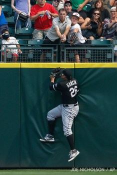 Chicago White Sox right fielder Avisail Garcia can't reach a two-run home run off the bat of Seattle MarinersÕ Robinson Cano during the fifth inning of a baseball game Sunday, Aug. 23, 2015, in Seattle. (AP Photo/Joe Nicholson)