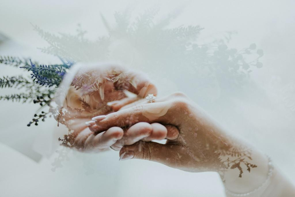 Two hands holding each other isolated in white background