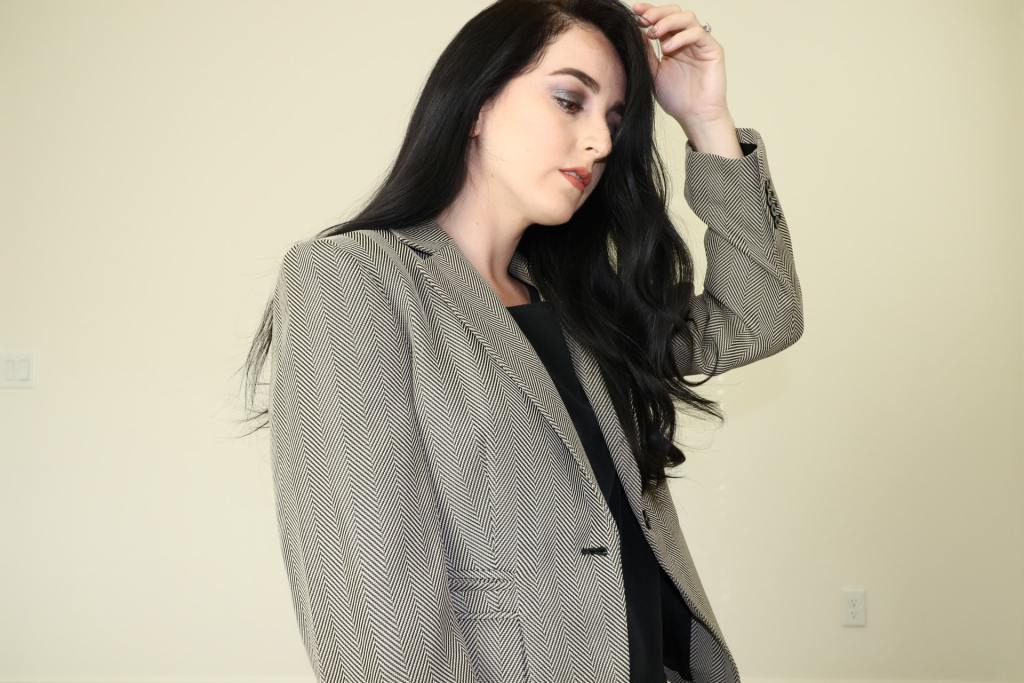 Woman in gray suit jacket
