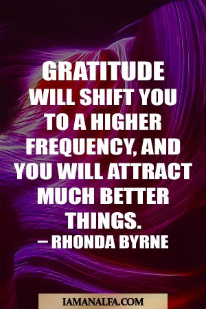 Inspirational quote about gratitude in front of neon lights by Rhonda Byrne