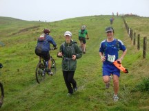 MTBs and runners sharing a short section of the road.
