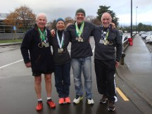 Showing our bling - Rob, me, Gerry and Graeme.