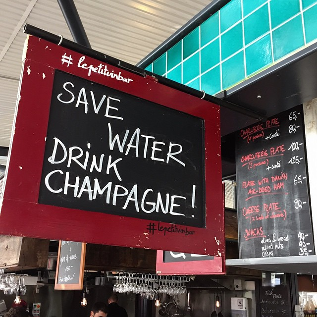 Le Petit Winebar Torvehallerne - Save Water, Drink Champagne sign