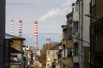 Smoke stacks of the Sofia Thermal Power Plant over residential buildings.