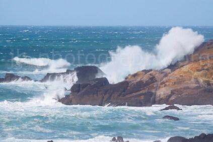 Surf crashing on the cliffs near Dunquin