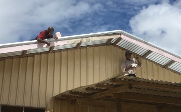 Ben and Nathaniel painting the trim on the Kotidanga Baptist Church building