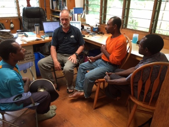 John, Ben, and Yali share some translation insights with Jack Naudi (2007 Kotidanga Baptist Bible School graduate), who works with missionary Jason Ottosen in Komako. (Nov. 2015)