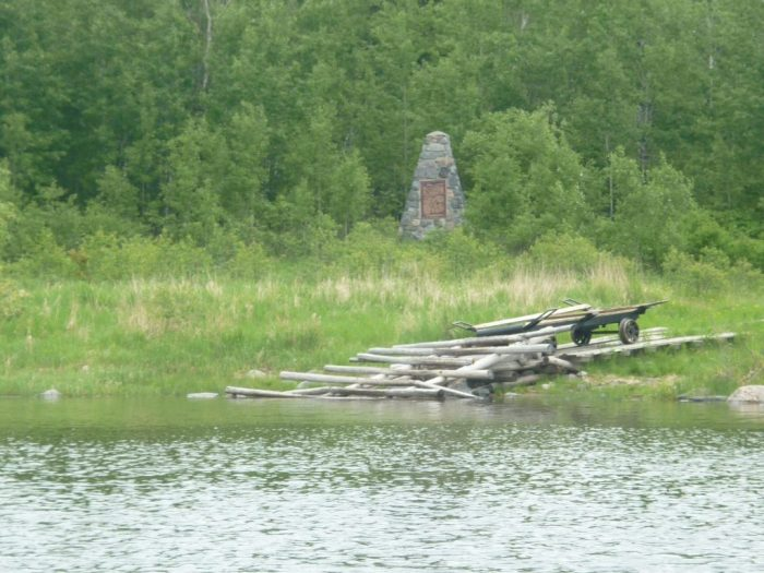 Commemorative plaque and cairn at the Churchill River end of the Frog Portage