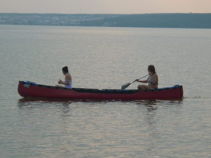 Two young women from Black Lake take 'Big Red' for a paddle