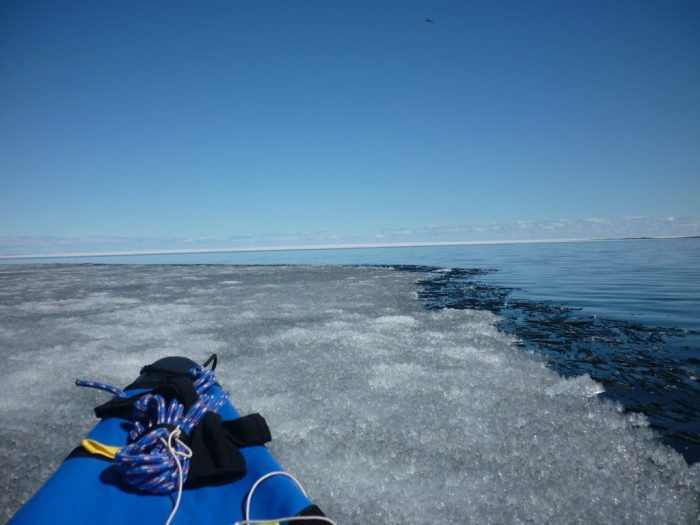 Although the ice edge appears fragile, trying to be an ice breaker and ramming it with the canoe has little effect!