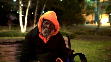 George is a homeless man. He has been in Jacksonville for 3 years but homeless since 2009. He is sitting outside of the Florida Theatre waiting on concert goers to leave.
