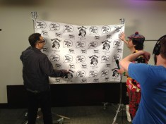 Fred helps Nardwuar fix the backdrop