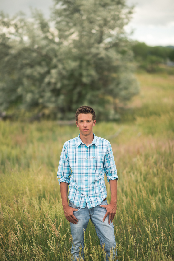 Denver high school senior photo standing in field