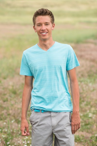 Denver high school senior photo smiling in field