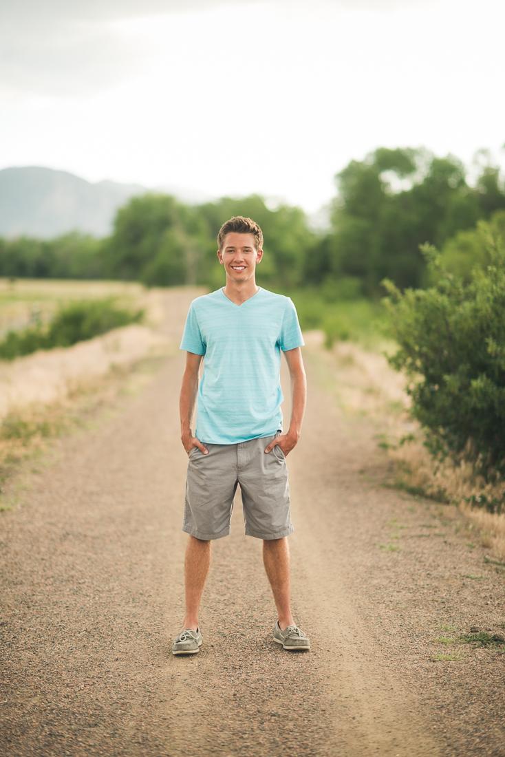 Denver high school senior photo smiling on a trail