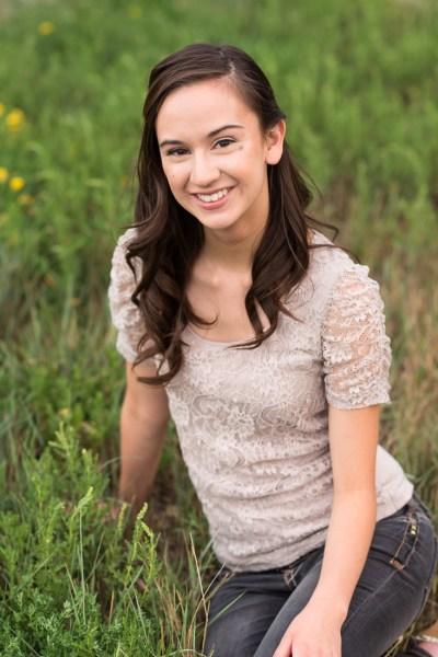 high school senior girl sitting in grass