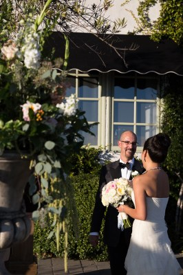 groom looks at bride and smiles during wedding
