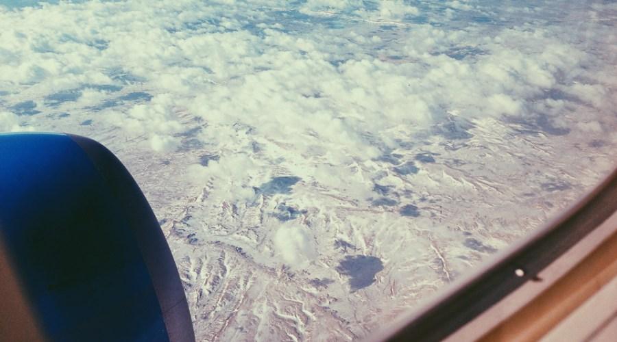 Southwest Air window seat cloudy snowy landscape iphone vsco