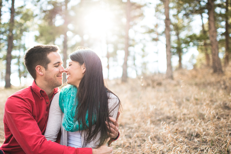 Evergreen engagement photography laughing couple in a forest