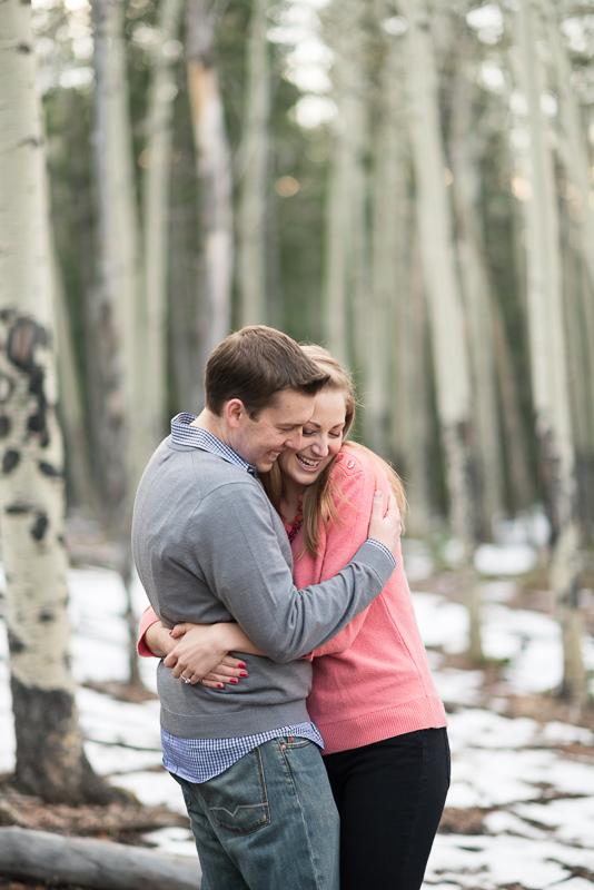 Evergreen Engagement Photos hugging in aspen trees