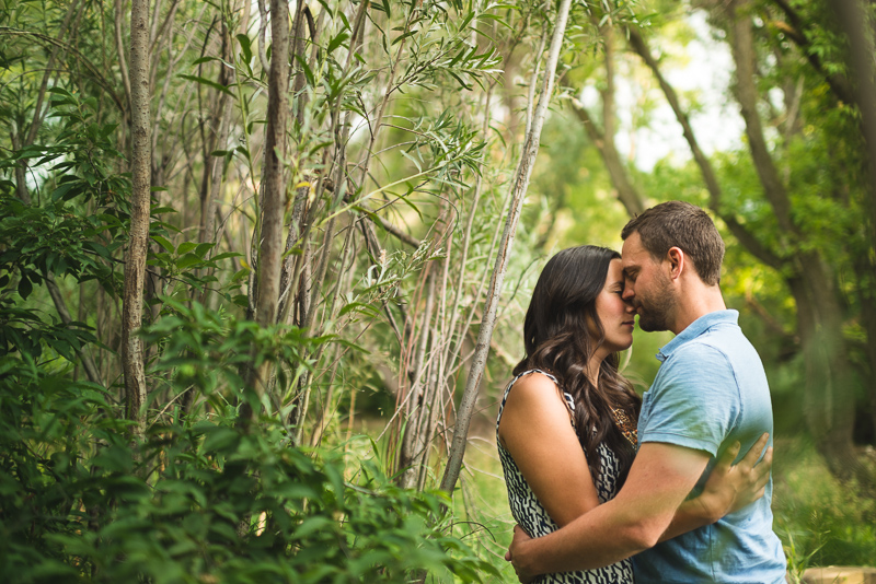 Golden Engagement Photography couple in trees