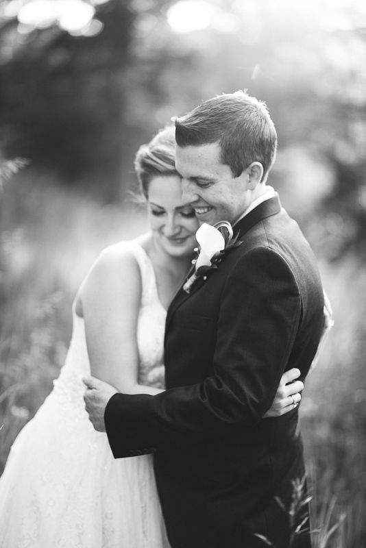 Golden Wedding Photographer black and white smiling couple