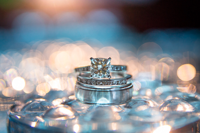 Golden Wedding Photographer ring shot bokeh