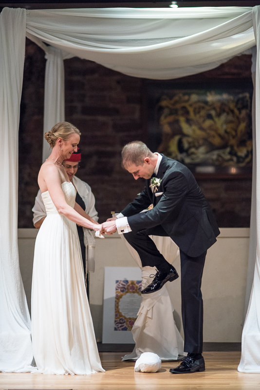 Denver Opera House Wedding Photographer smashing glass