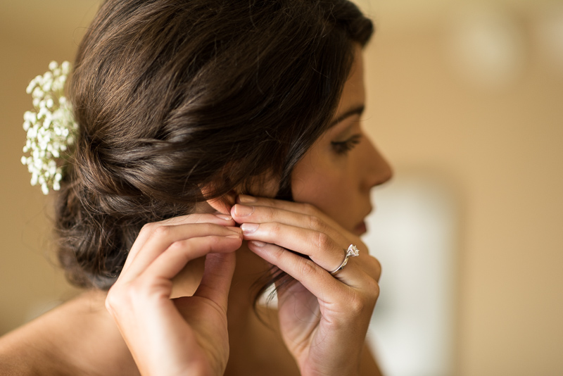Boulder Wedding Photography bride putting earring on