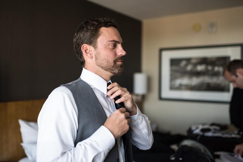 Denver Wedding Photography History Colorado groom putting on tie