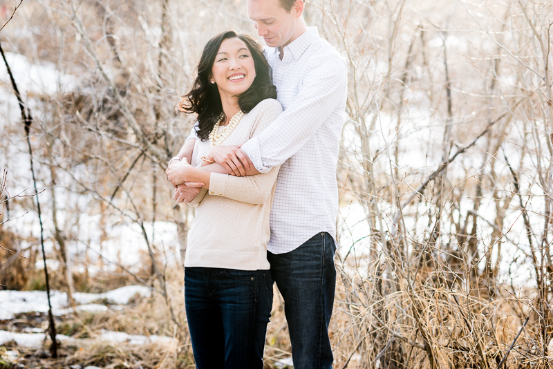 Denver engagement photography couple hugging in trees