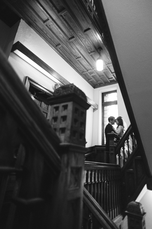 denver wedding photography stairwell kiss