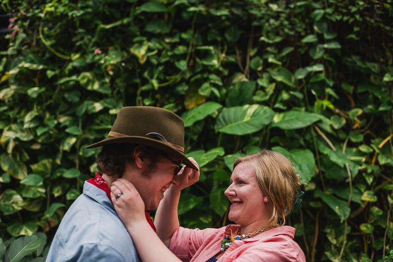 Denver Engagement Photography adjusting hat