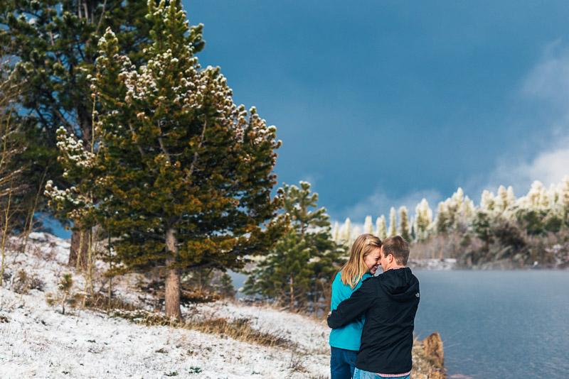 Boulder Engagement Photography pine trees snow lake