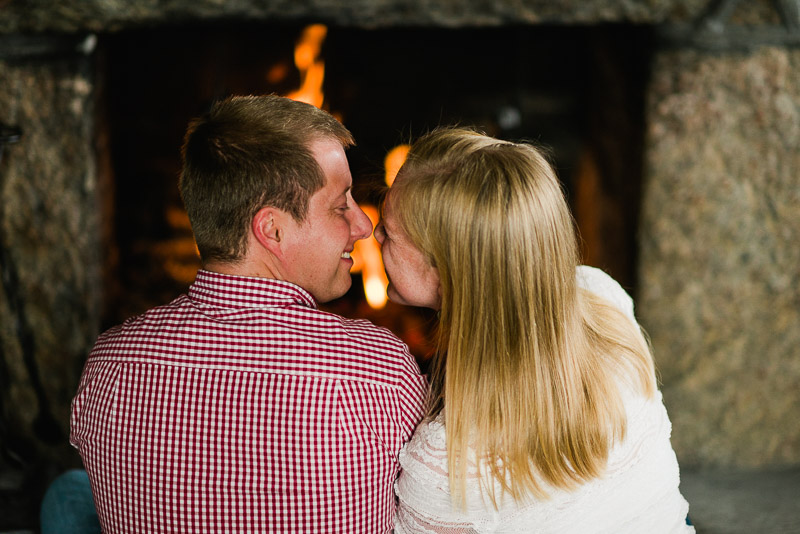 Boulder Engagement Photography sitting by fire