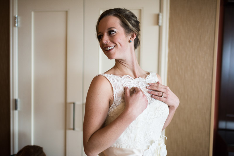 Denver Wedding Photography Cherokee Ranch and Castle bride getting in dress
