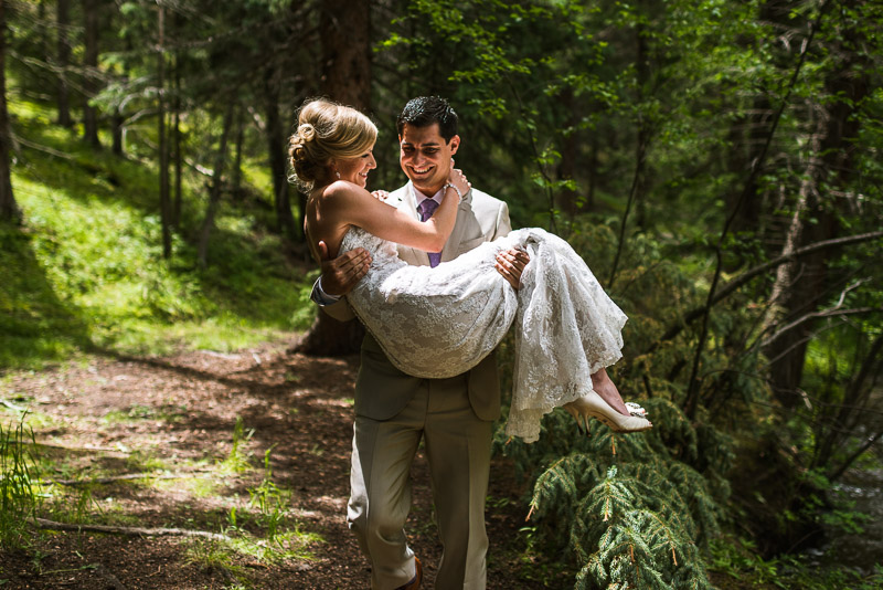 Emily and Ryan Lower Lake Ranch Wedding Photography groom carrying bride