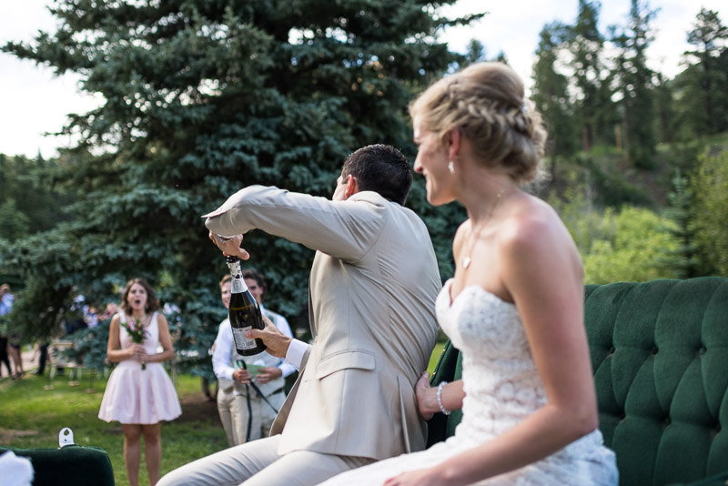 Emily and Ryan Lower Lake Ranch Wedding Photography popping champagne