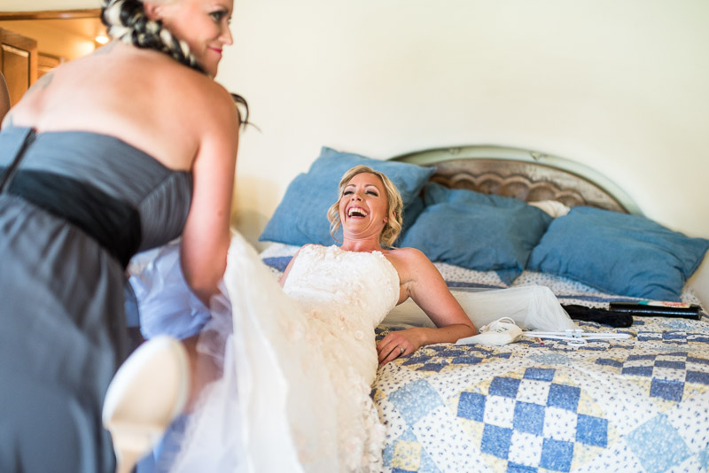 Cuchara Wedding Photographer bride laughing garter