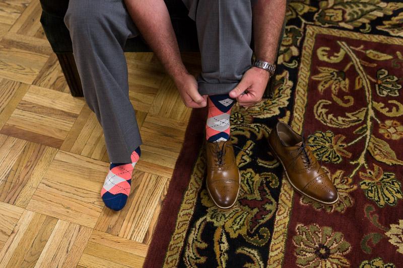 Denver athletic club wedding groom getting dressed