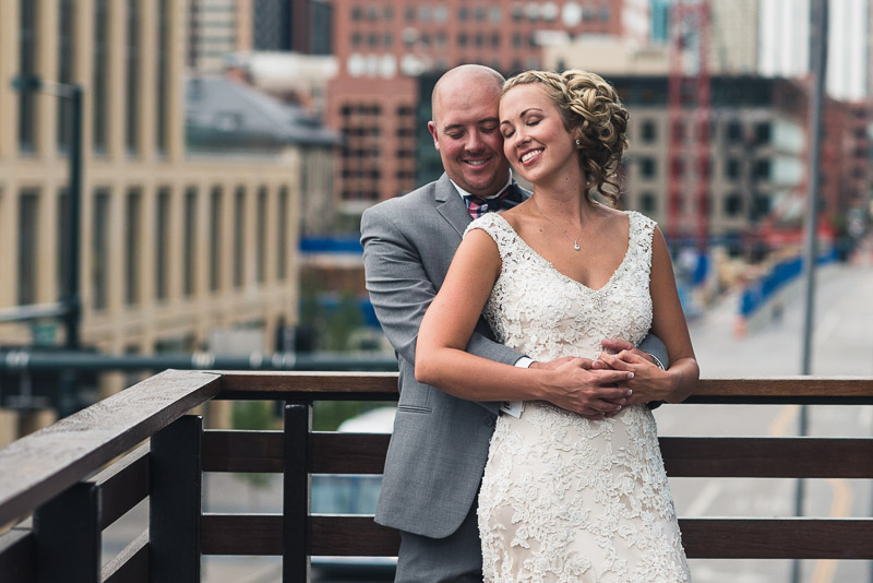 Denver athletic club wedding happy couple on bridge