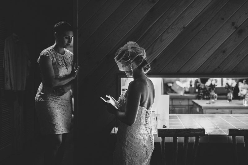 Lake Tahoe Wedding Photographer bride checking phone