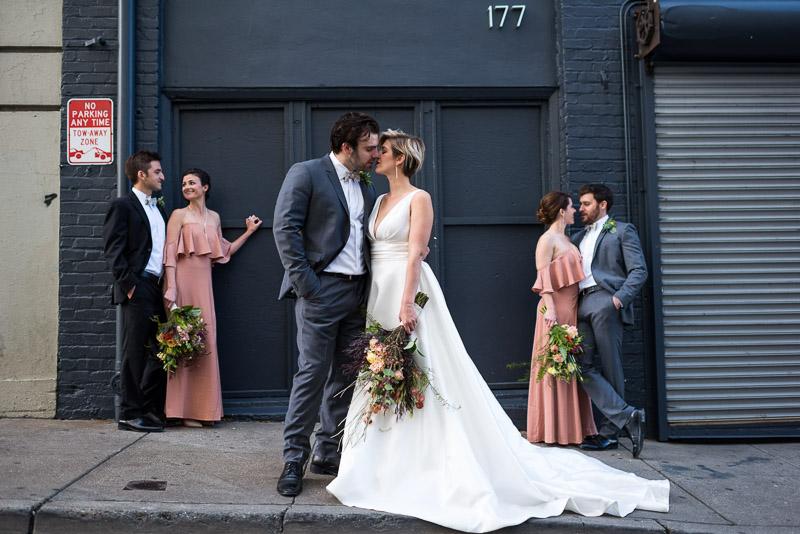 Bridal party kissing