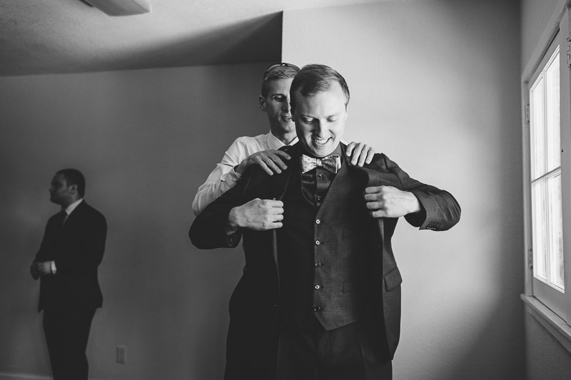 San Francisco Wedding Photography Villa Chanticleer groom putting on jacket