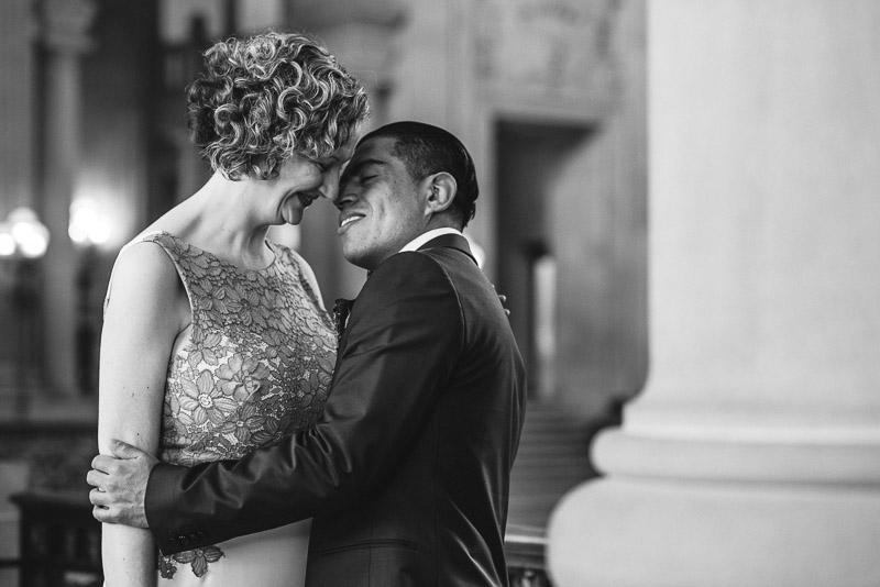 san francisco city hall bride and groom kiss