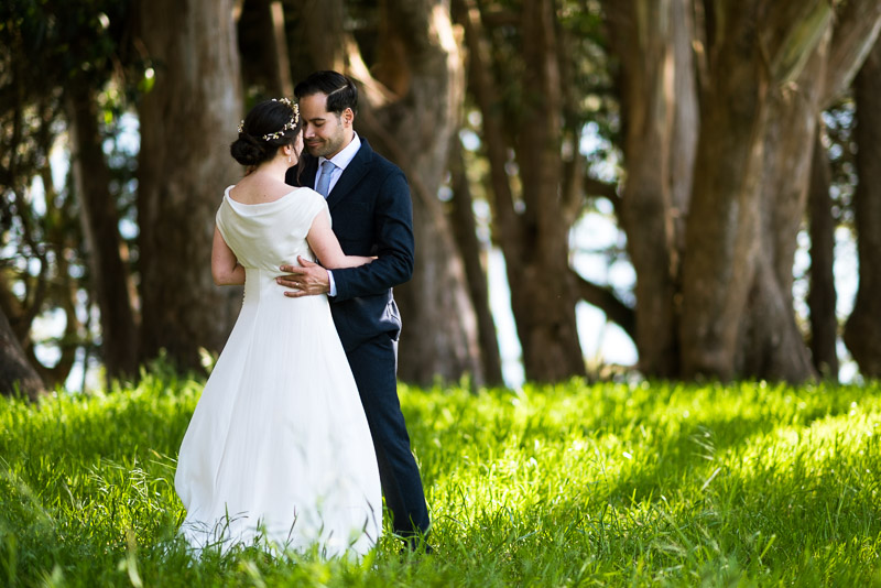Strauss home ranch wedding couple in grass