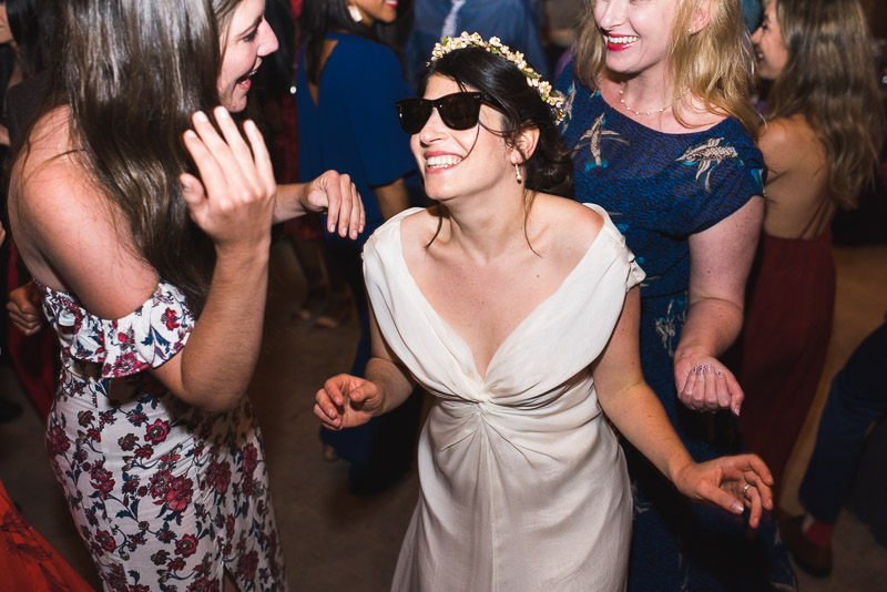 Strauss home ranch wedding bride dancing with sunglasses